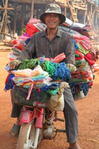 Bicycle Peddler with piles