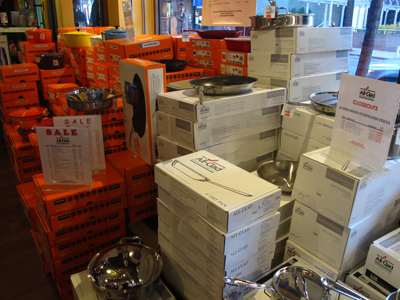 Piles of All Clad at discount