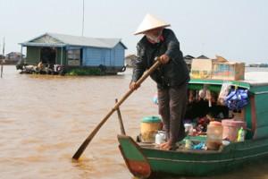 Cambodia boat people on Ton Le Sap