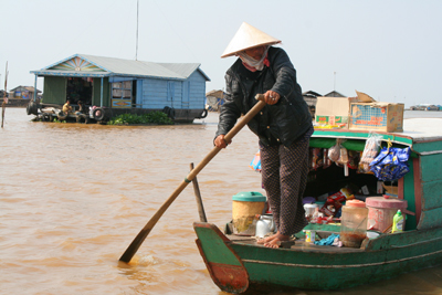 Cambodia boat people on Ton Le Sap