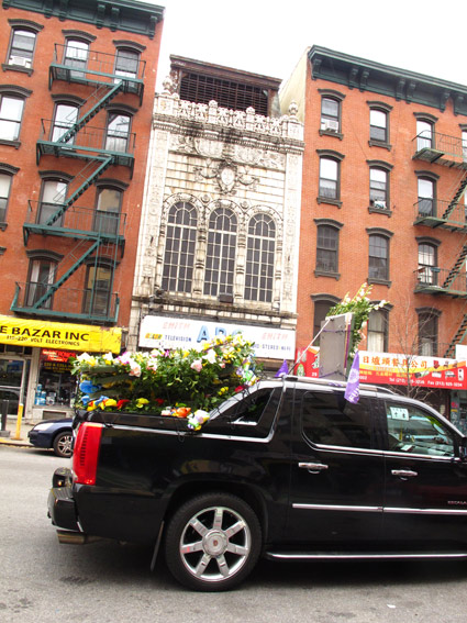 Chinese funeral and Loews Canal Theater building, NYC