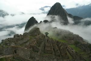 Machu Picchu emerging from clouds, #Peru