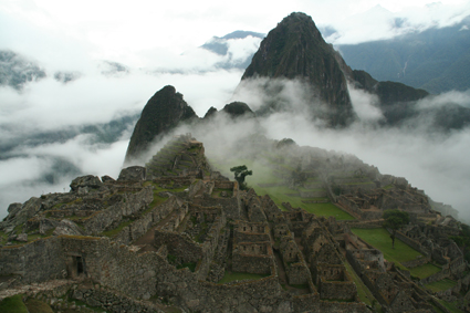 Machu Picchu emerging from clouds, #Peru
