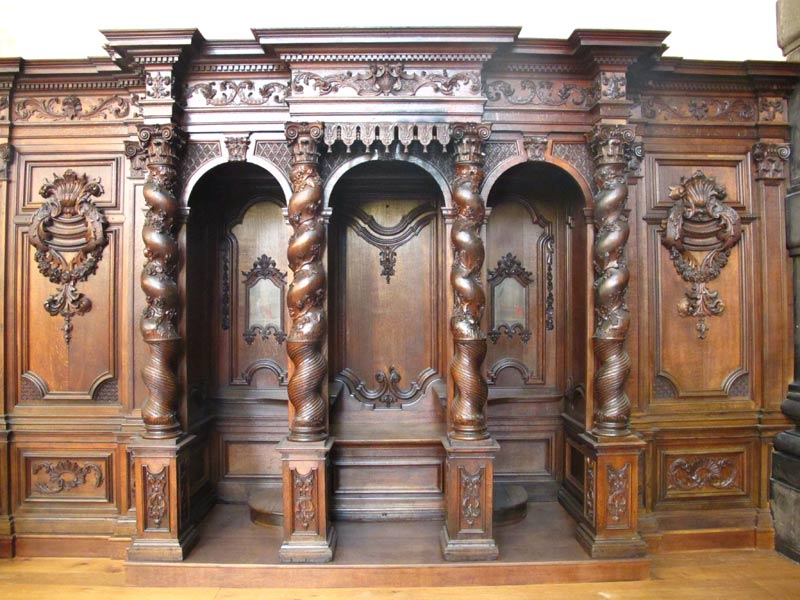 ornate, carved Baroque style wooden confessional
