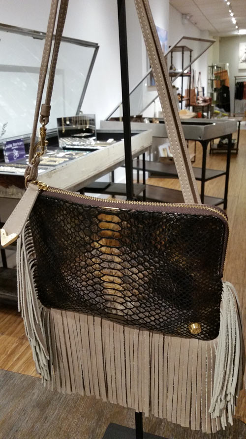 Designer handbag at multi-designer store