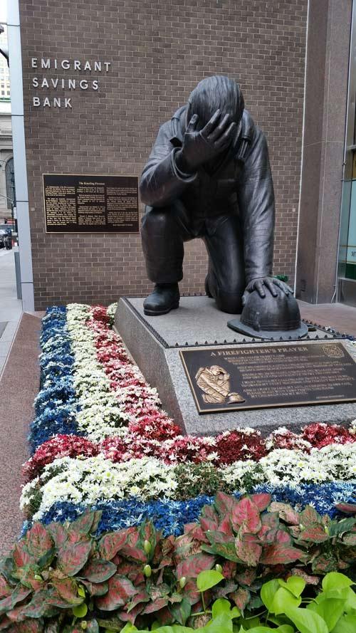 Kneeling Fireman memorial on East 43rd Street NYC