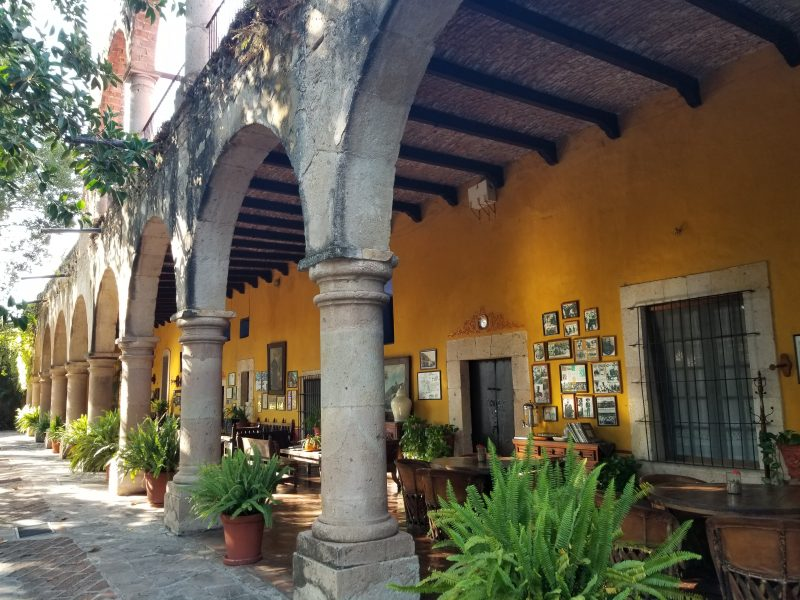Antique-filled corridor at Hacienda el Carmen
